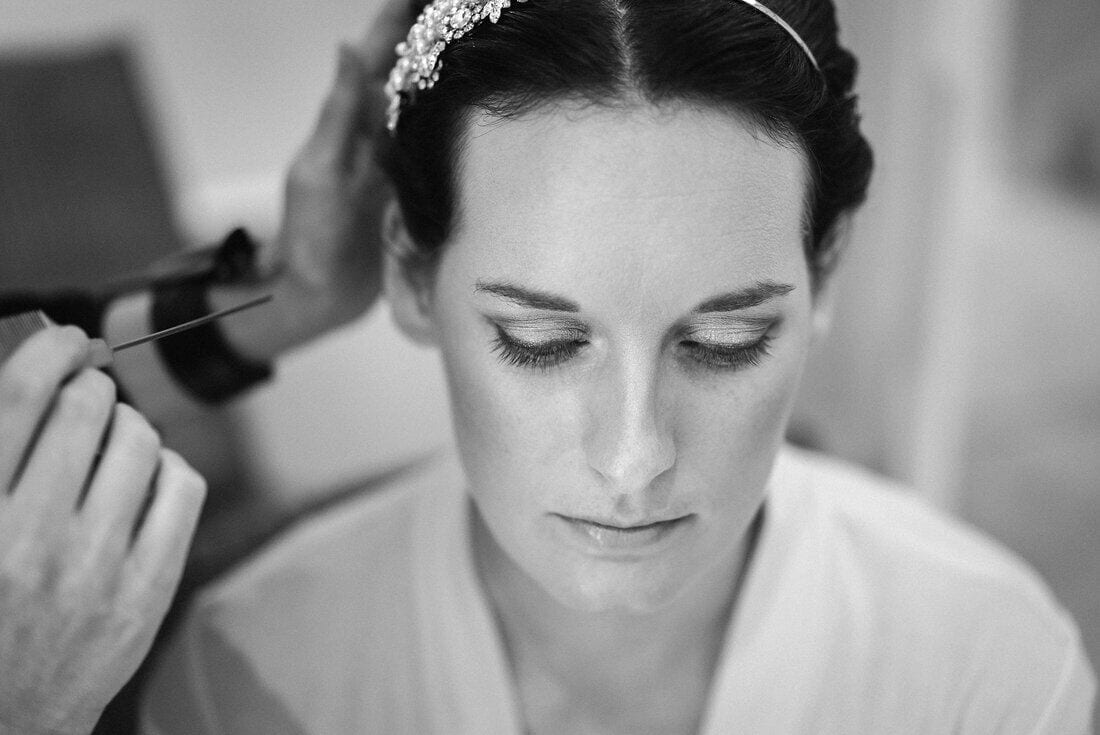 bride gets her hair and makeup done