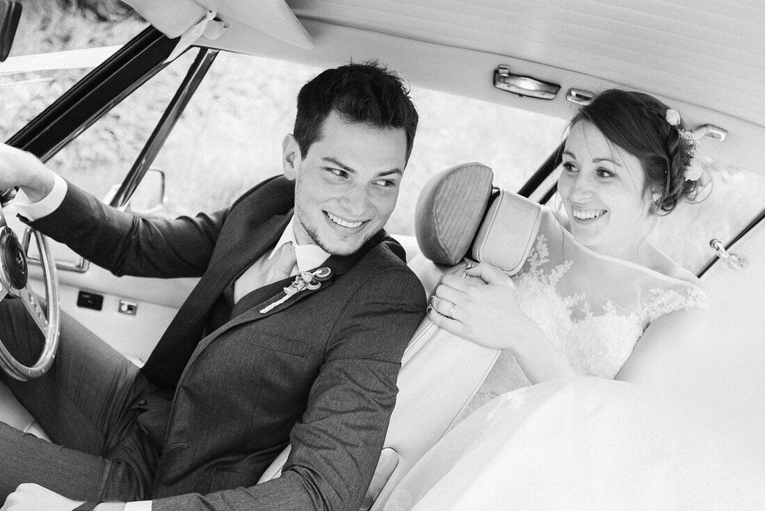 bride and groom take a drive as husband and wife