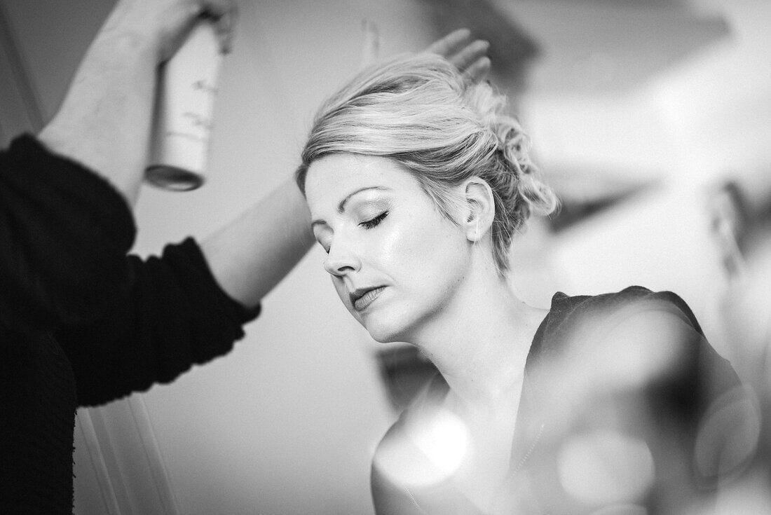 the final touches to the hair on the wedding day