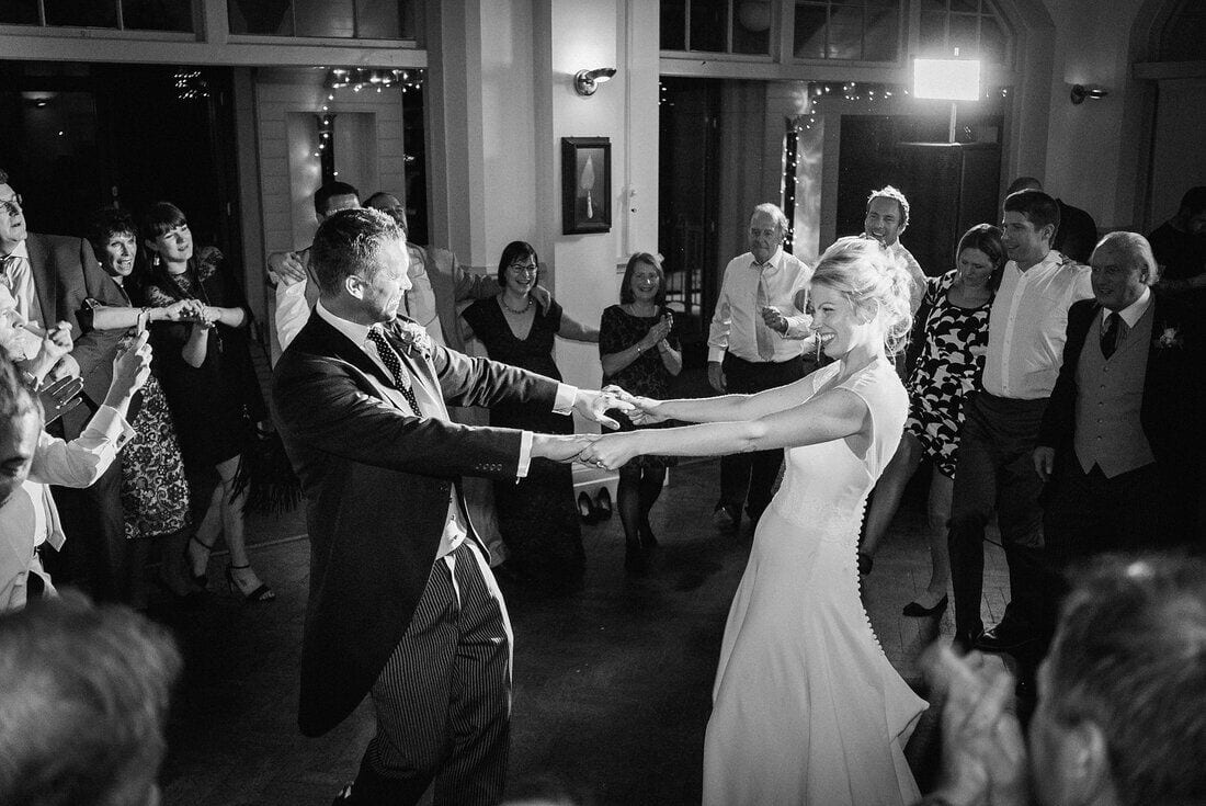 the bride and groom take to the dance floor one last time
