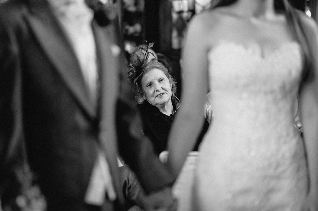 the mother of the bride listens intently