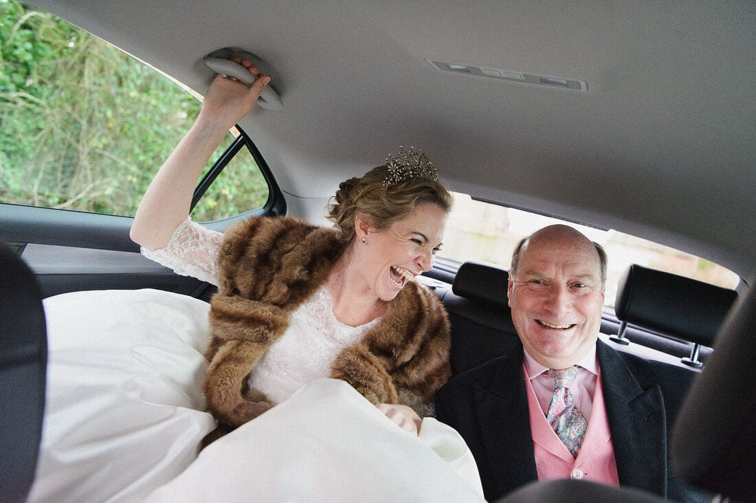 the father of the bride and his daughter on the way to church