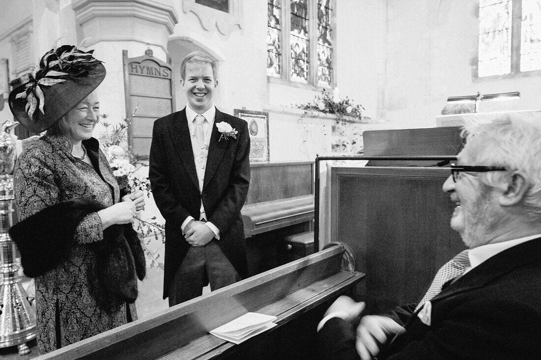 the groom waits in church for the wedding to begin
