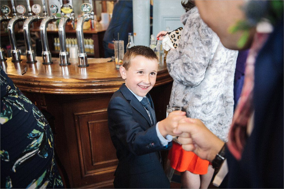 a fist bump with the groom