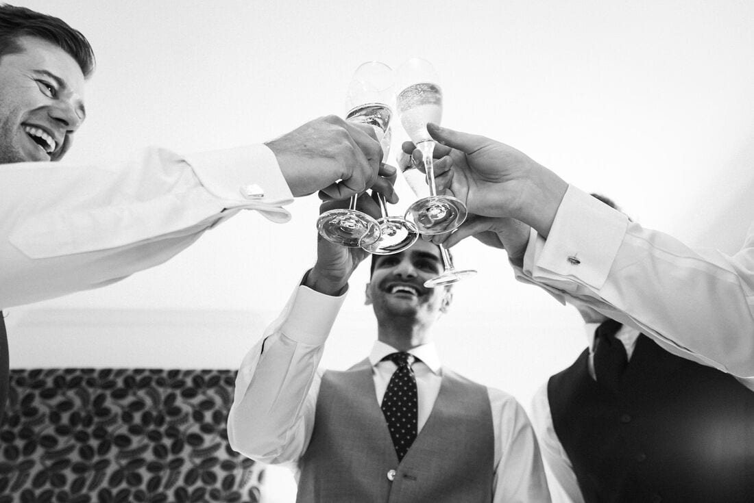 groomsmen cheer on the morning of the wedding