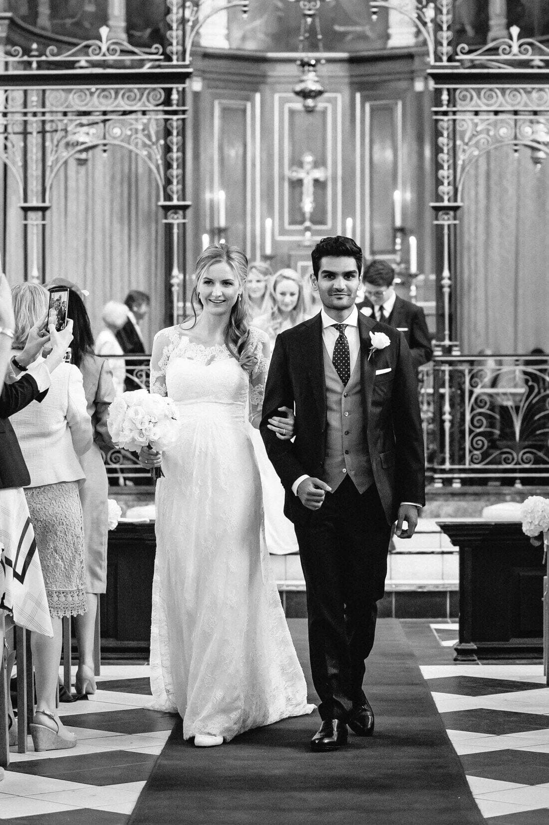 Sophie and Anish leave Holy Trinity Church Guildford after their wedding ceremony