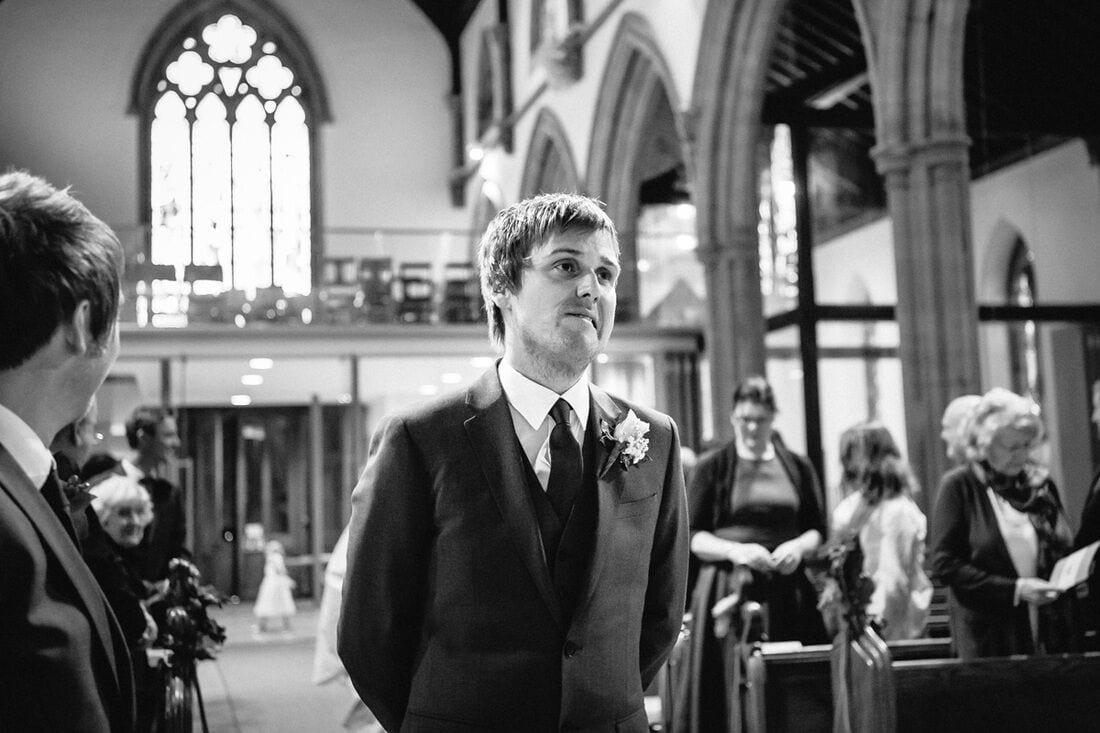 the groom waits anxiously