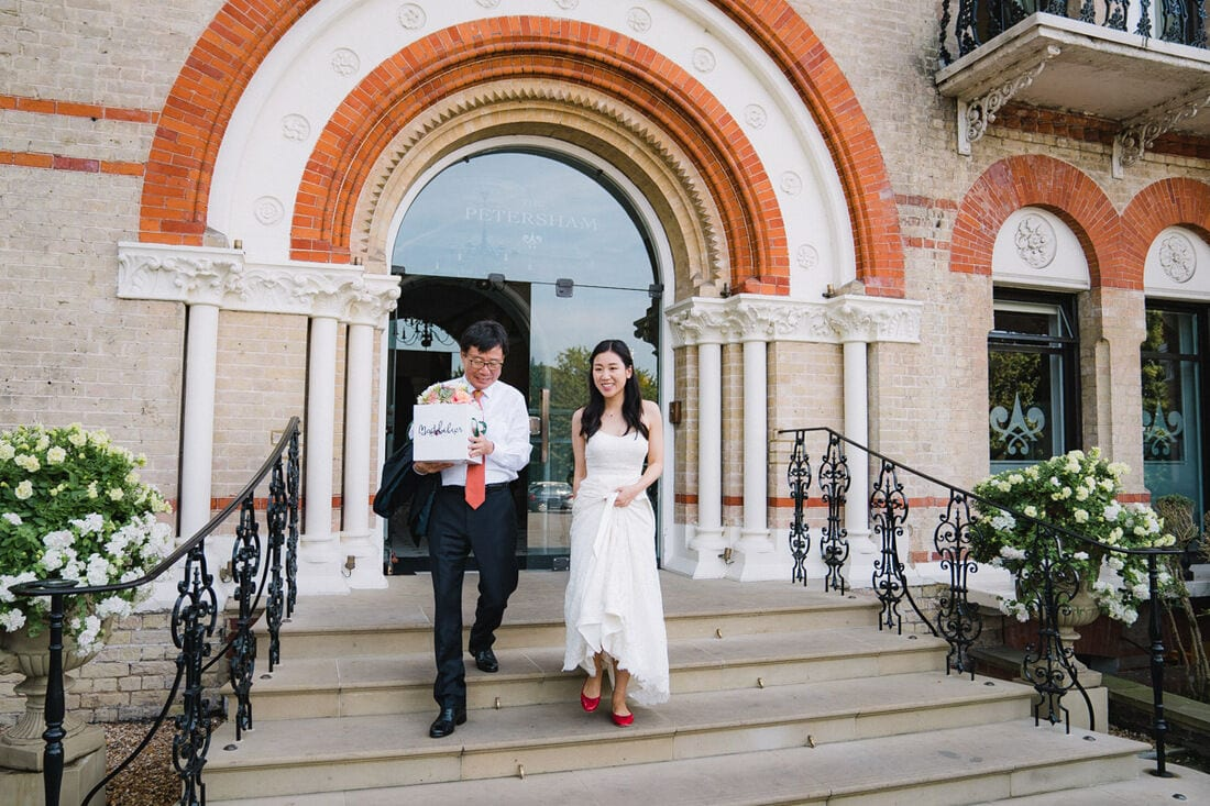 bride and her father leaving the petersham hotel near richmond park