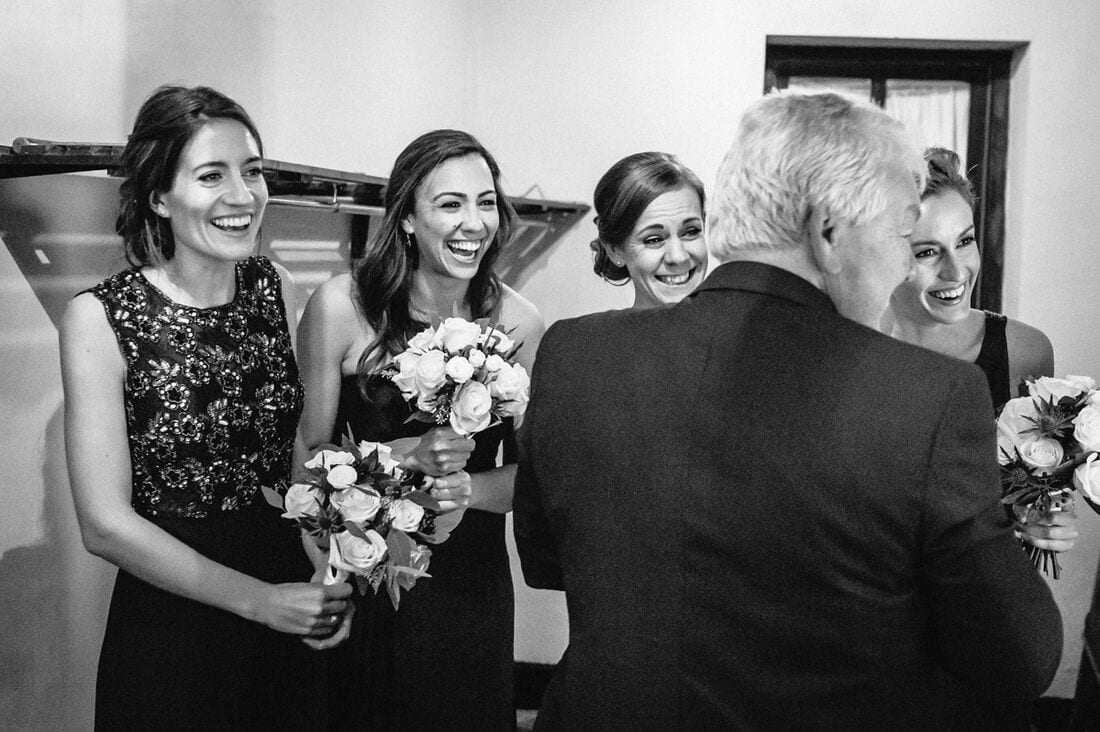 bridesmaids react to the arrival of the bride