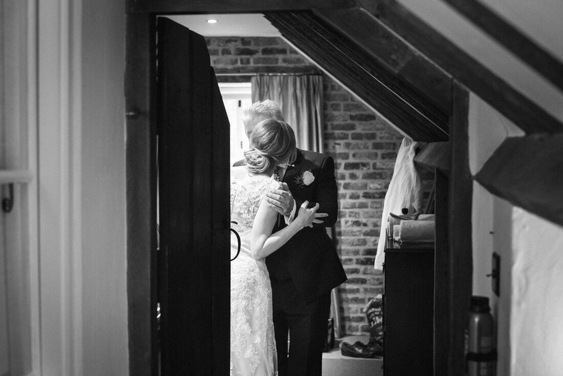 bride and her father have a moment before the wedding day begins