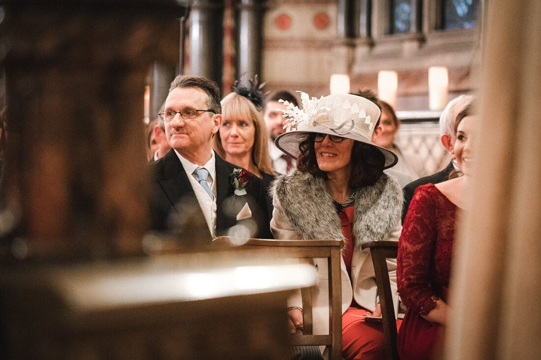proud parents watch as their daughter gets married