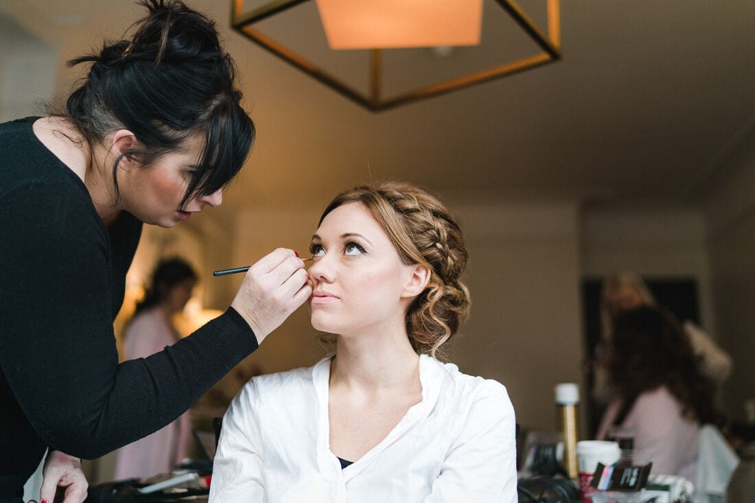 the bride getting here makeup applied