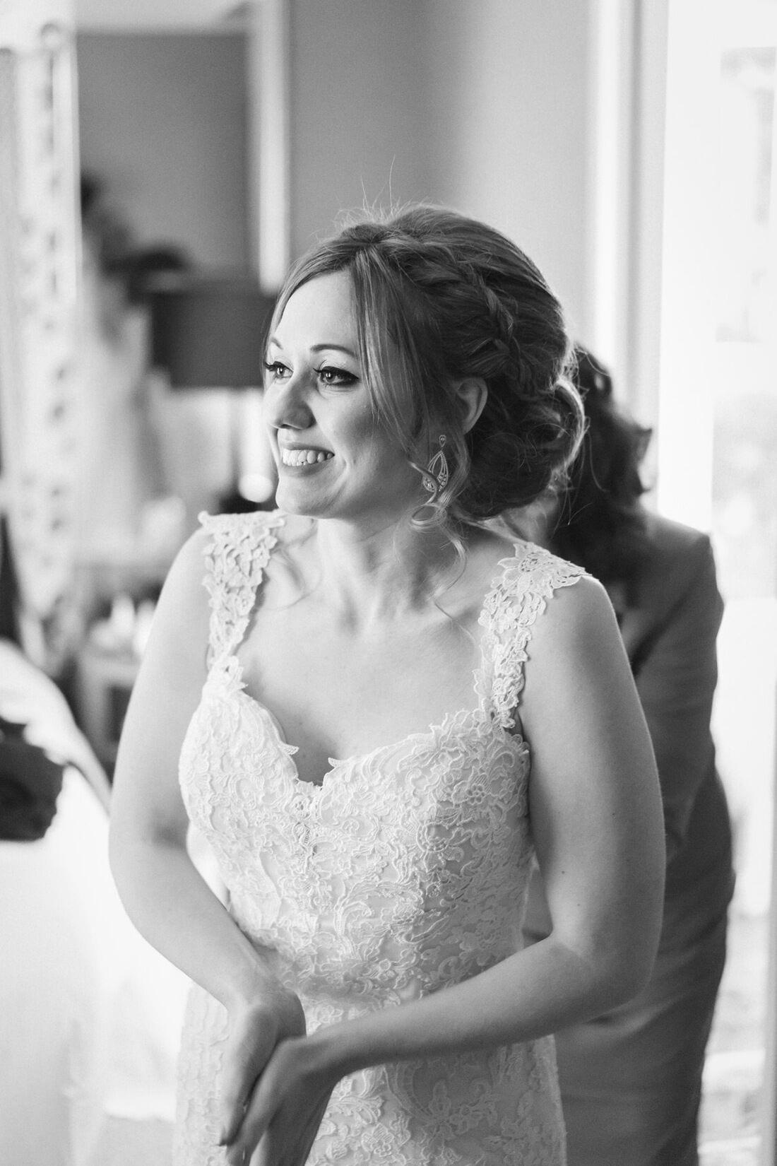the happy bride in her wedding dress