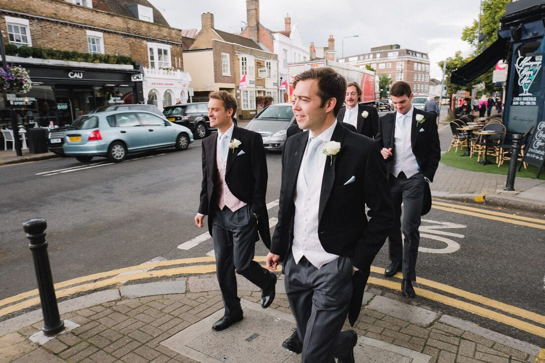 groom and ushers make their way to church