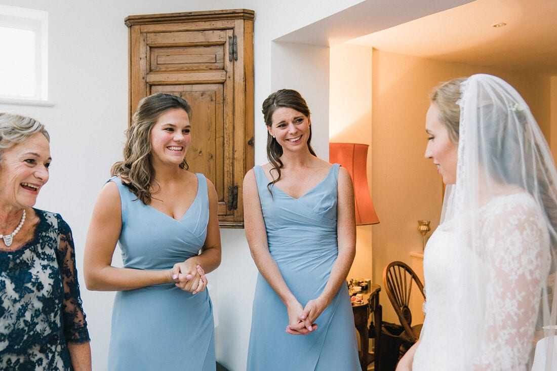 emotional bridesmaids as the dress goes on