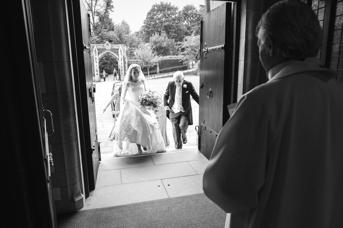 the bride arrives for her ceremony at the sacred heart wimbledon