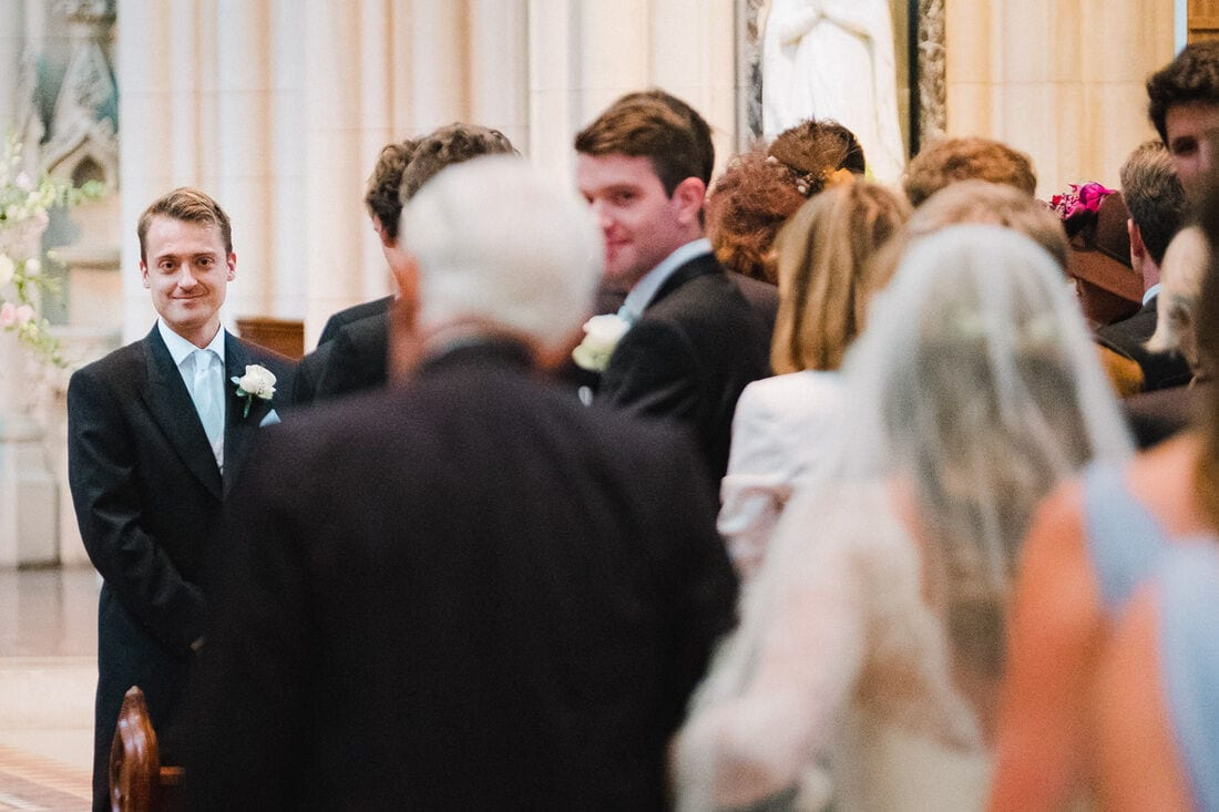 the groom catches sight of his bride for the first time