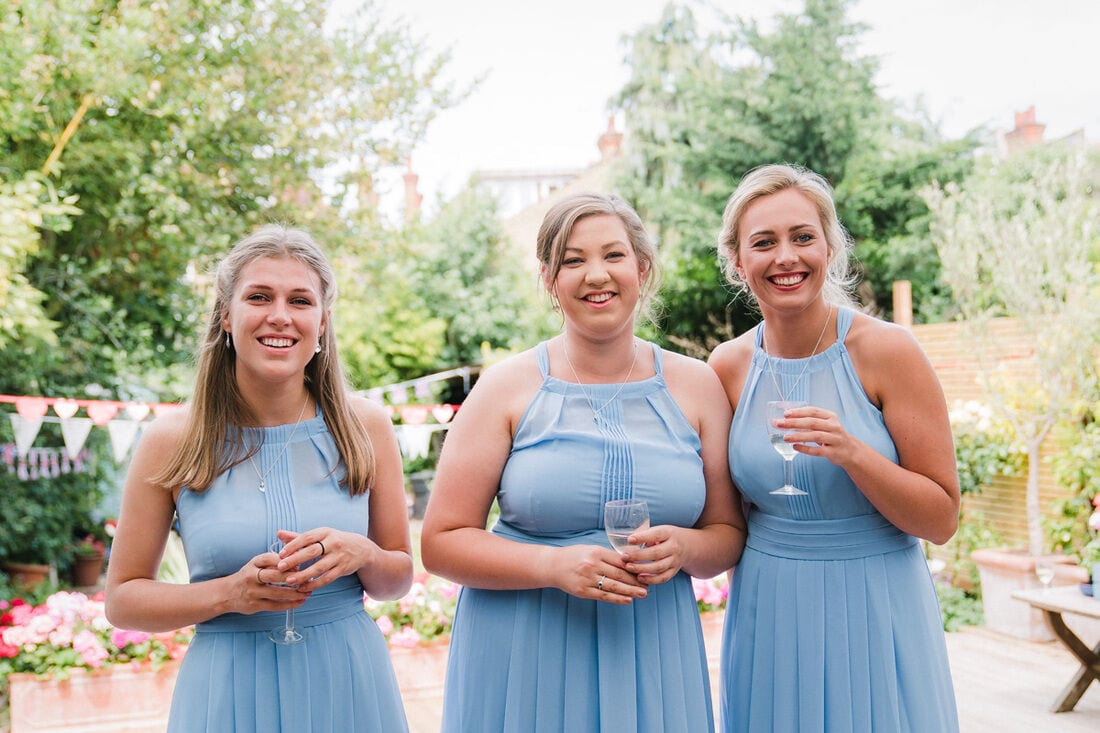 the bride is revealed to her bridesmaids