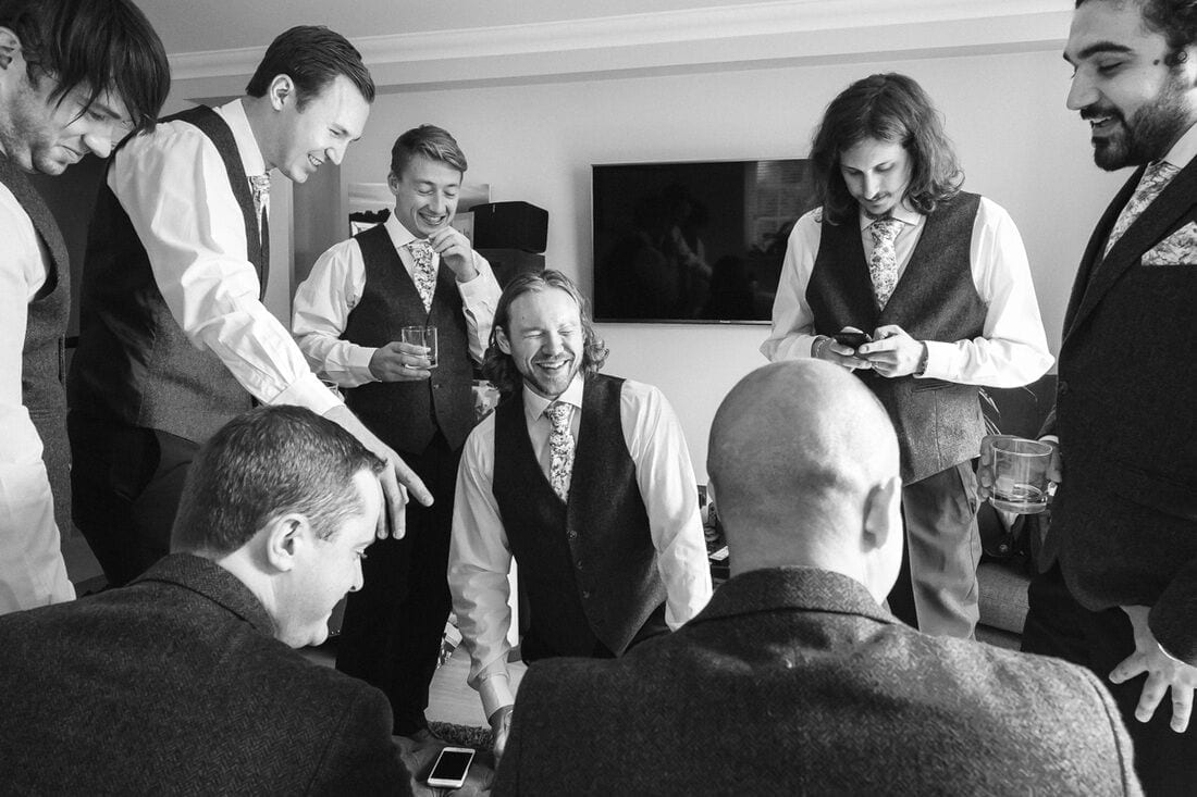 the groom and his ushers make final preparations