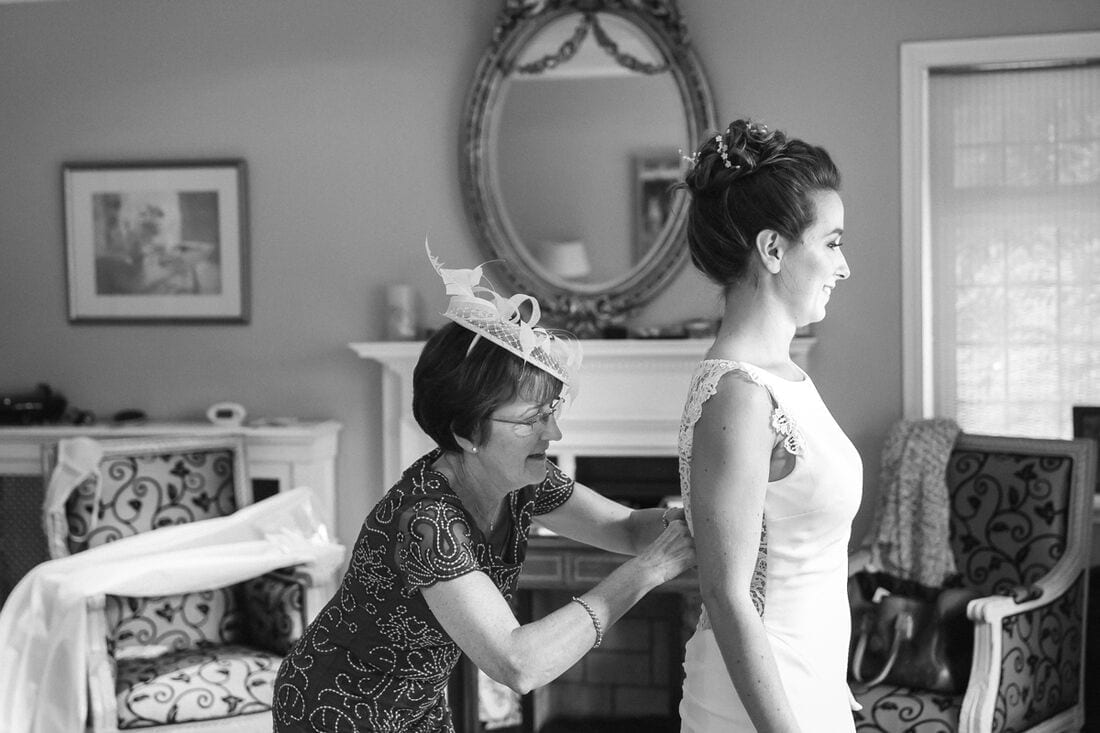 mum fixing her daughter's wedding dress