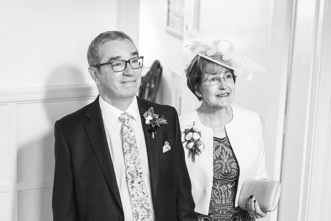 proud mother and father of the bride