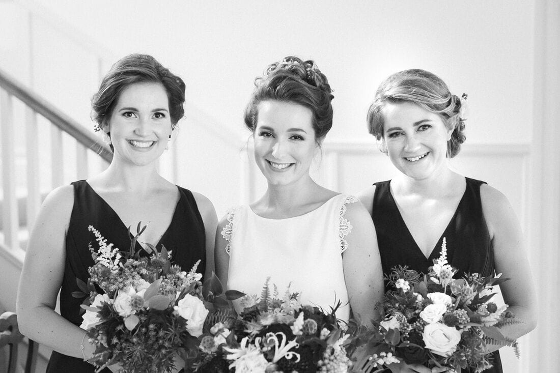 a portrait of the bride and her bridesmaids