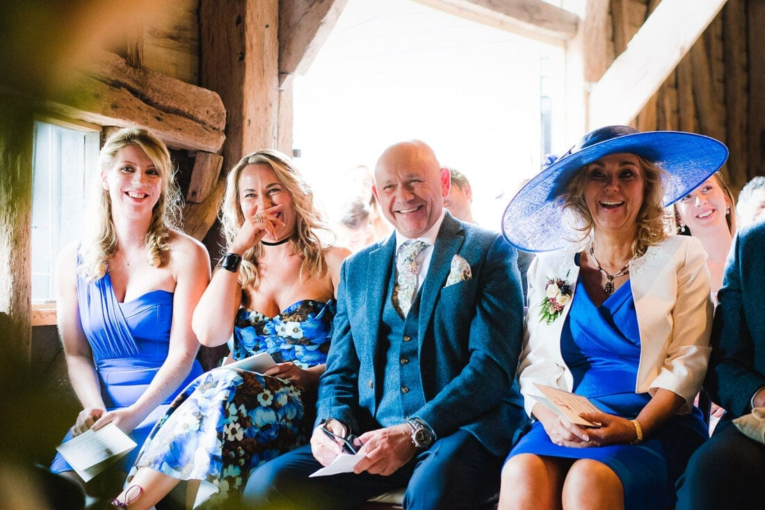 laughter during the wedding at high billinghurst farm in surrey