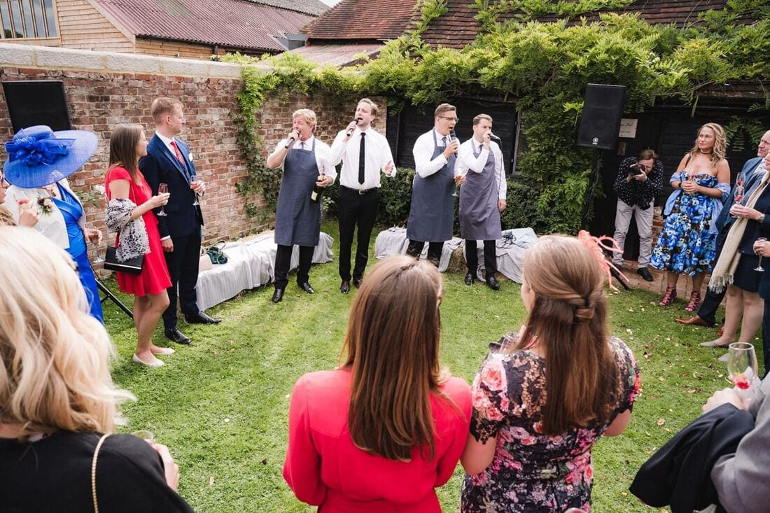 wedding guests are entertained by an a cappella singing group