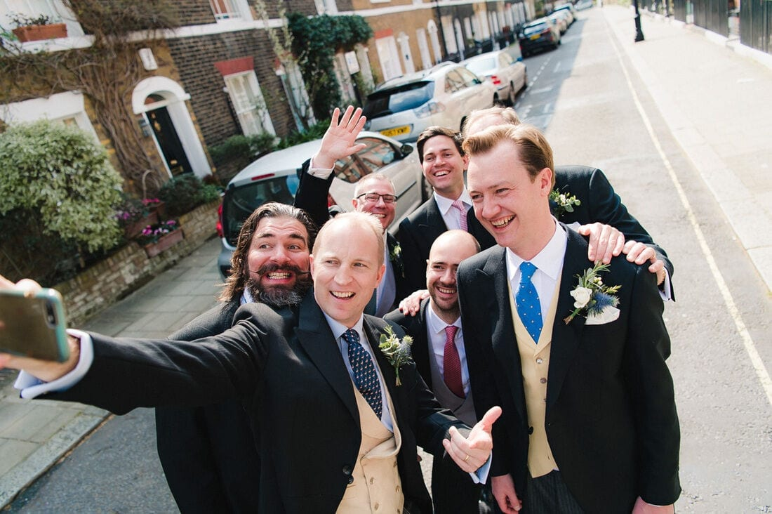 a selfie with the groom and his ushers