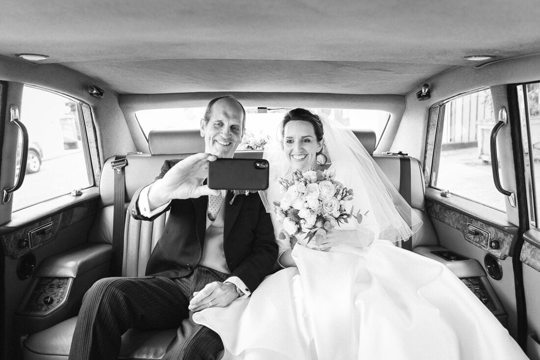a selfie with dad and the bride on their way to church