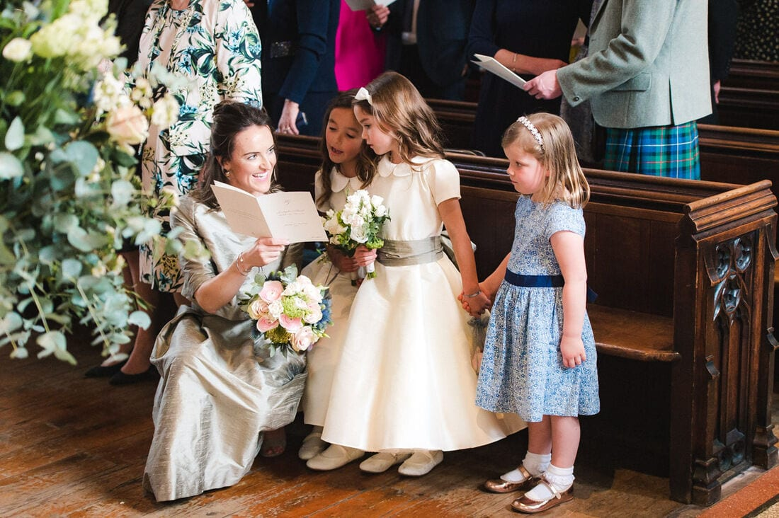 maid of honour and flower girls singing the hymns