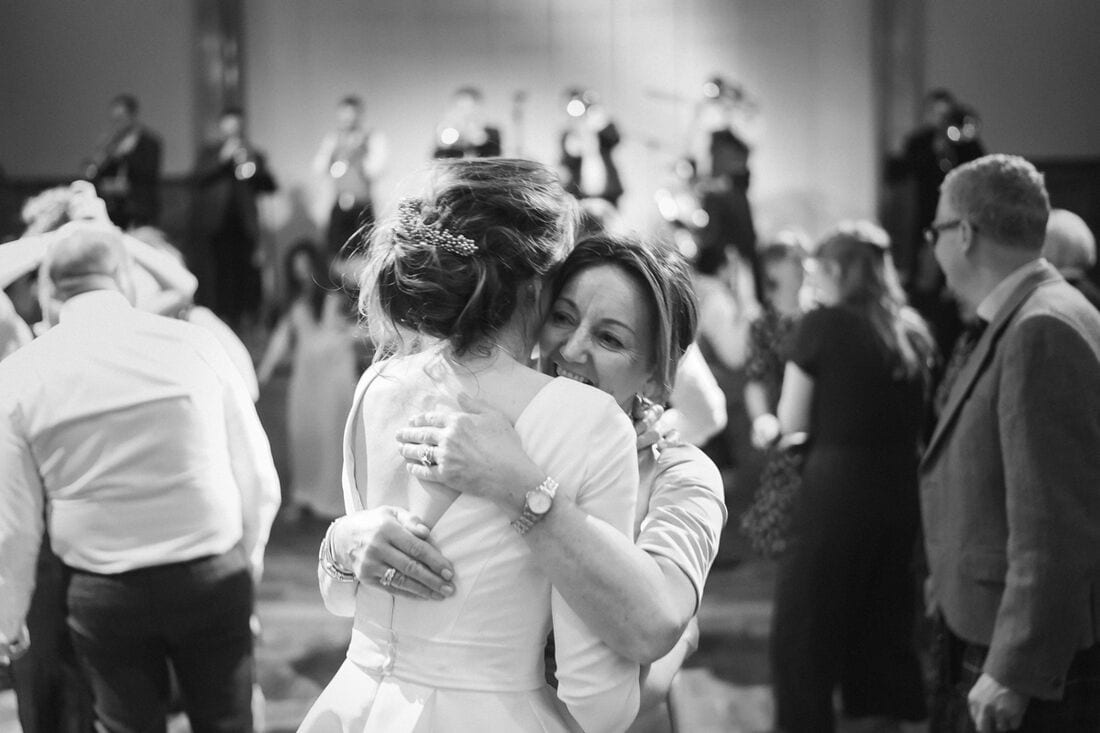 a special hug between mum and the bride