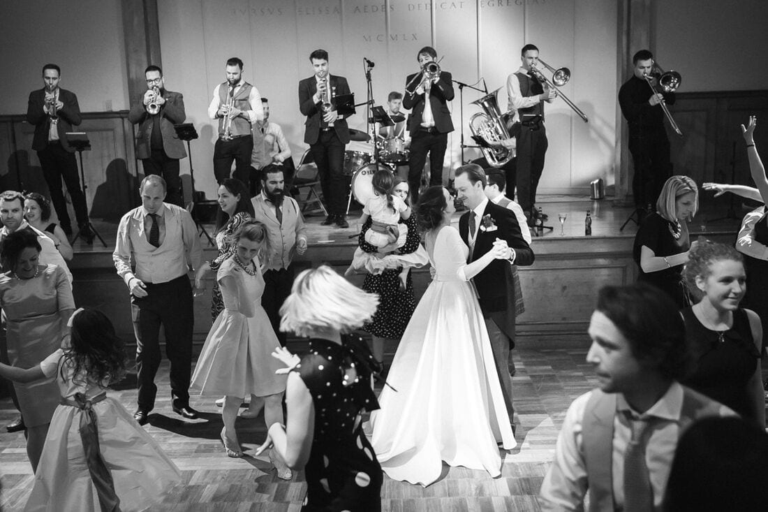 a wide scene with the married couple on the dance floor