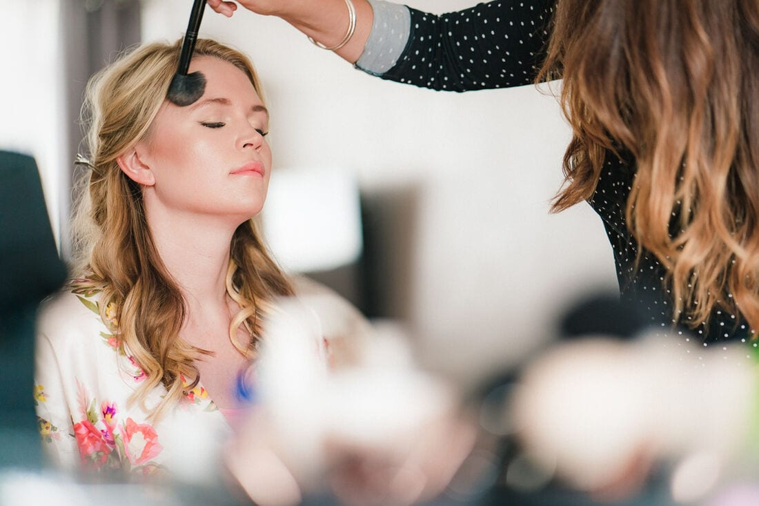wedding makeup being done before the bride gets married