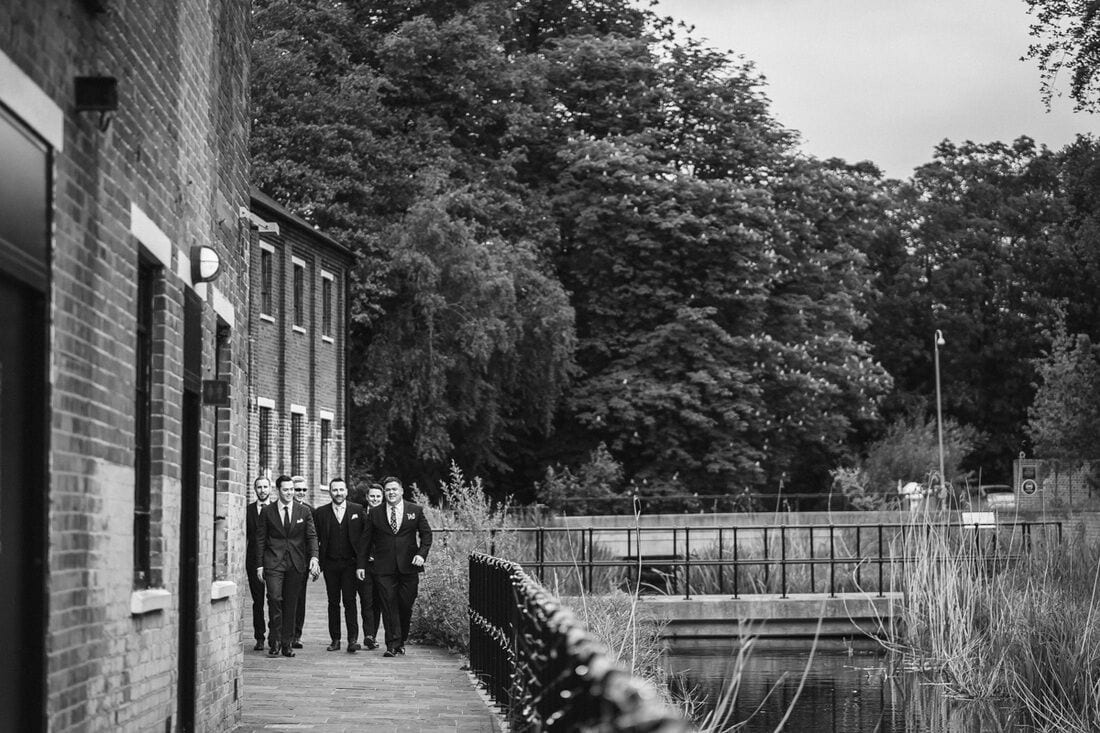 groom and ushers arrive at bombay sapphire distillery for the wedding