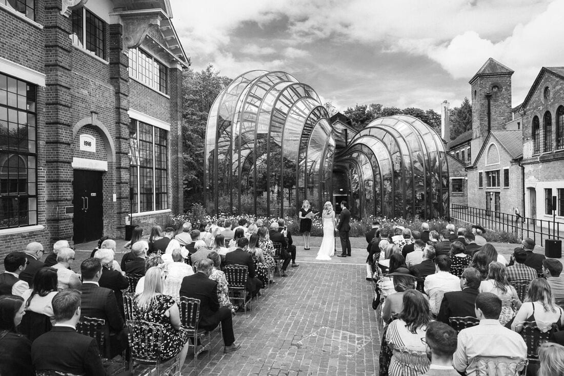 wedding in front of the glasshouse at Bombay Sapphire Distillery Hampshire