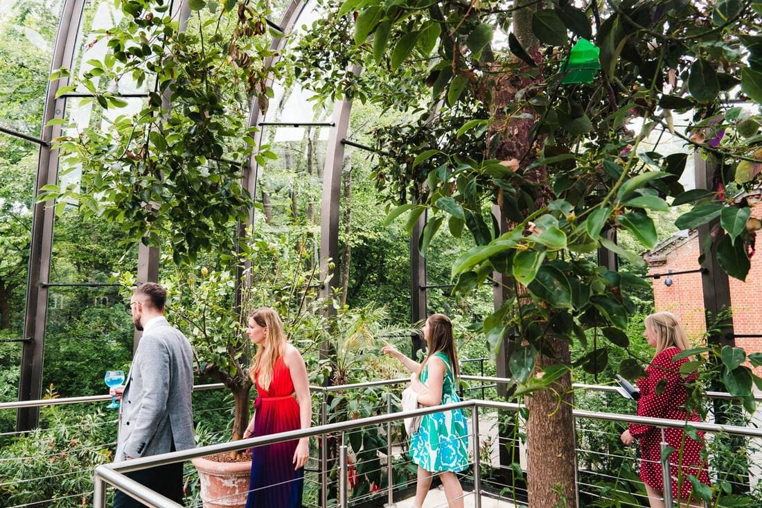 wedding guests explore the glass house at bombay sapphire gin distillery
