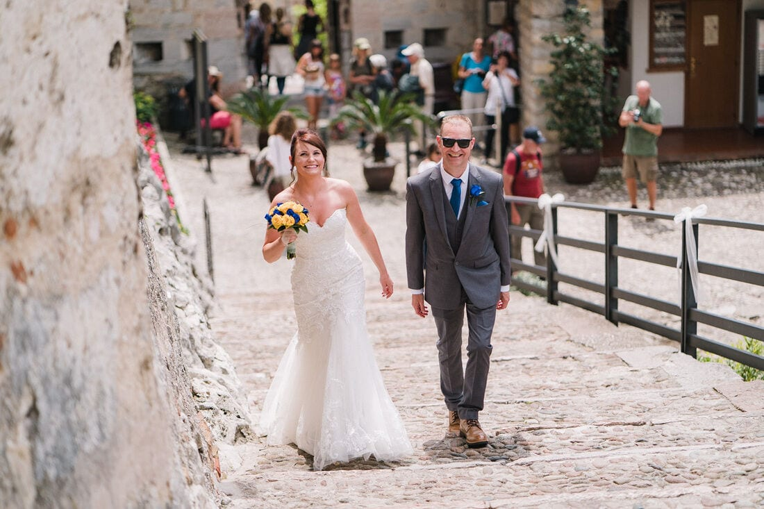 the bride arriving at malcesine castle for her ceremony