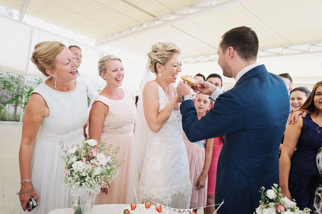 wedding guests and cake at lake garda wedding reception