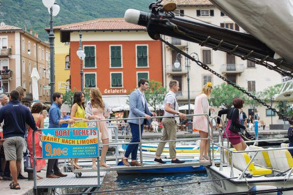 wedding guests boarding a boat on Lake Garda