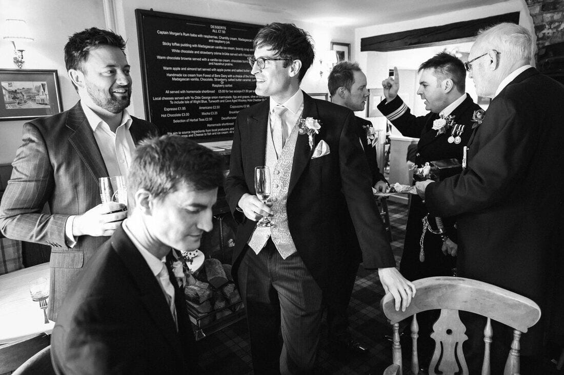 wedding guests meet at the pub