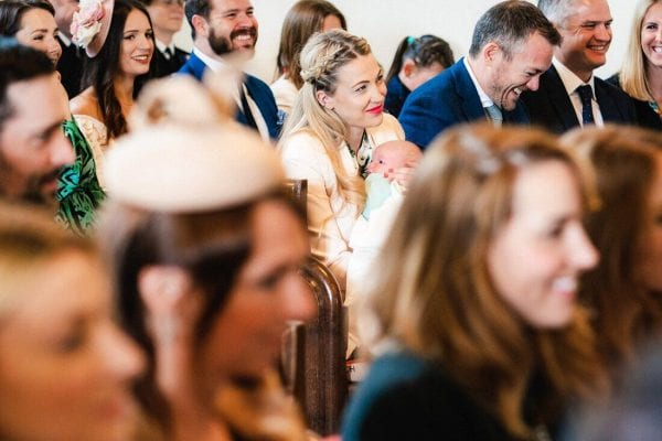 a smiley wedding guest and baby