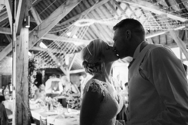a kiss between husband and wife on their wedding day