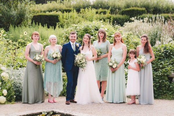 wedding group photo in the gardens at Loseley Park