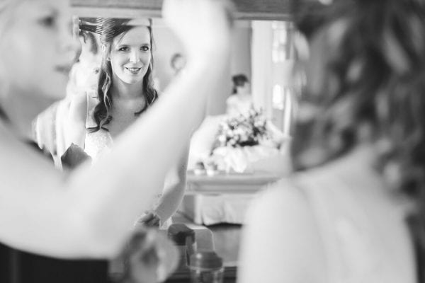 bride getting ready in the beautiful loosely park bridal suite