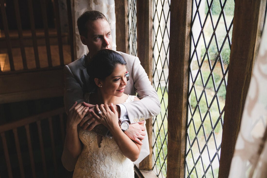 bride and groom portrait by window light