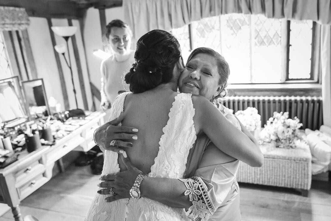 a hug from mum for the bride in her wedding dress