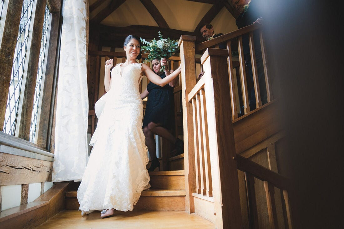 the bride descending the stairs at Cain Manor