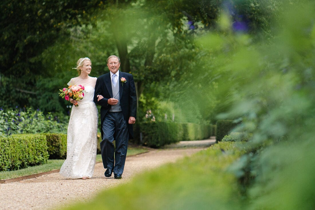 here comes the bride and her father to the wedding ceremony at chiswick house