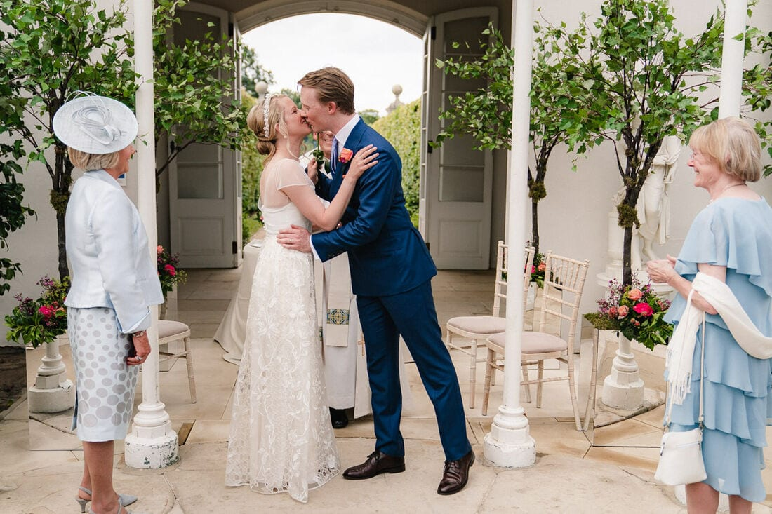 first kiss as husband and wife in the chiswick house glasshouse